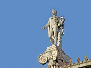 Greek God Apollo Statue on top of building